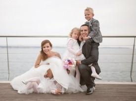 Poročno fotografiranje, morska poroka, poročna obleka.