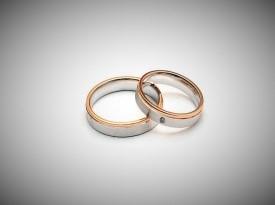 Poročna prstana iz belega in rdečega zlata.